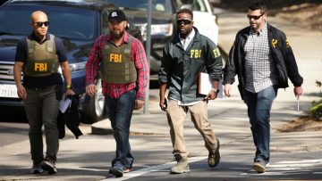 FBI agents are seen near Youtube headquarters following an active shooter situation in San Bruno, California